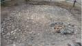 Siidan blogissa esitellään kesäkuussa Ilmari Itkosen kaivaman varhaismetallikautisen kodanpohjan rekonstruktio. Kuva: Siida.